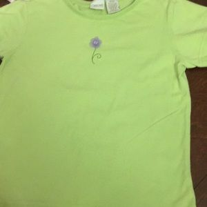 Green shirt with flower